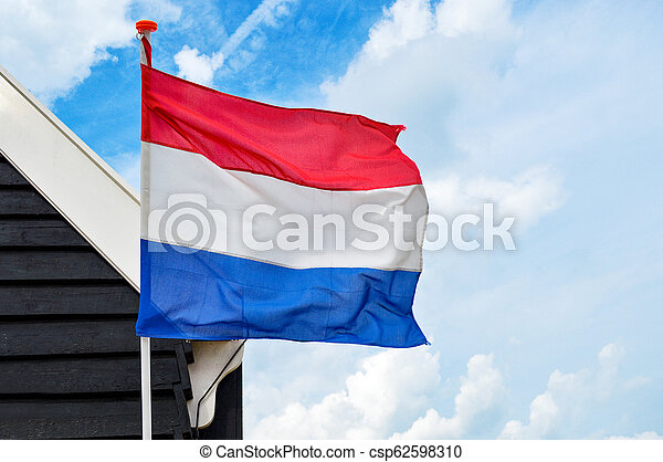 Netherlands flag waving in the wind - csp62598310