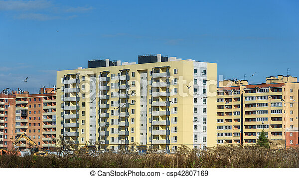 new apartment houses on background of blue sky - csp42807169