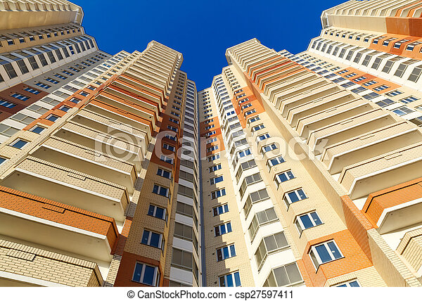 new building on background of blue sky - csp27597411