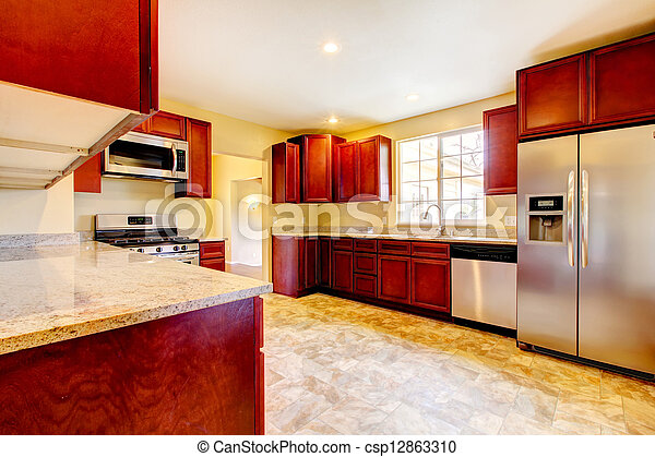 New cherry wood kitchen with stinless steal appliances. - csp12863310