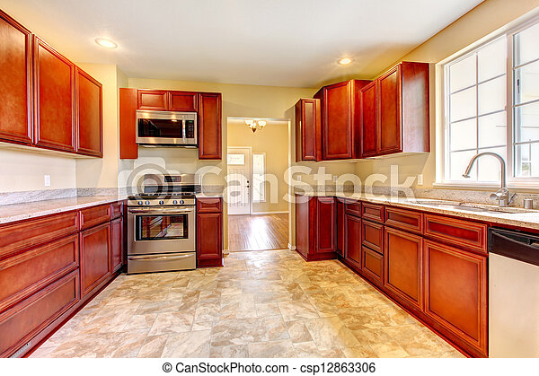 New cherry wood kitchen with stinless steal appliances. - csp12863306