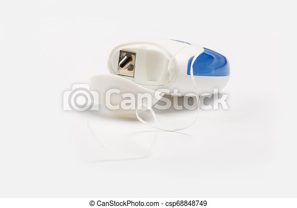 New dental floss isolated on a white background. - csp68848749