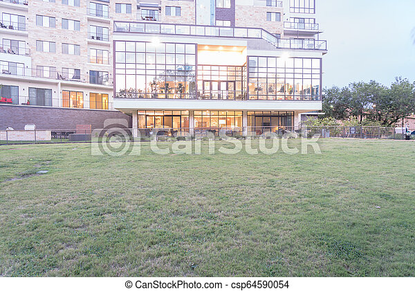 New development apartment building with large grass lawn - csp64590054