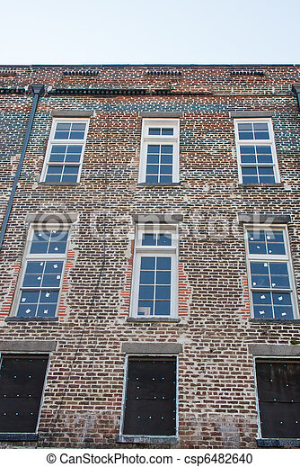 New Glass Windows in Old Brick Wall - csp6482640