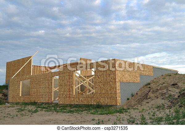 New house construction, framed walls of walk out basement - csp3271535