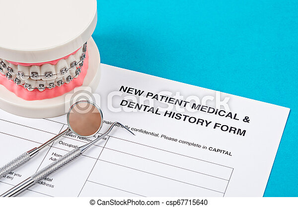 New patient medical form with model tooth and dental instruments. - csp67715640