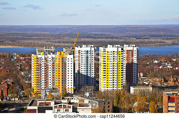 New Social apartment buildings in the residential area of Samara. Construction in the area of ??private houses on the banks of the Volga river. - csp11244656