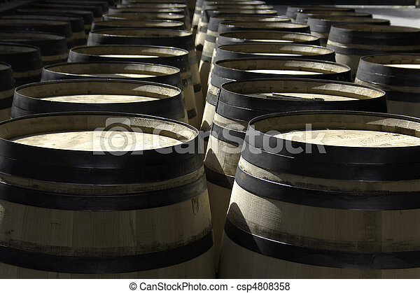 New wine barrels stored in rows - csp4808358