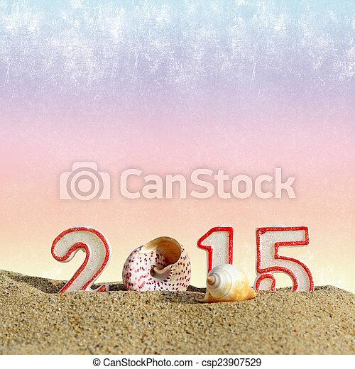 New year 2015 sign on a beach sand - csp23907529