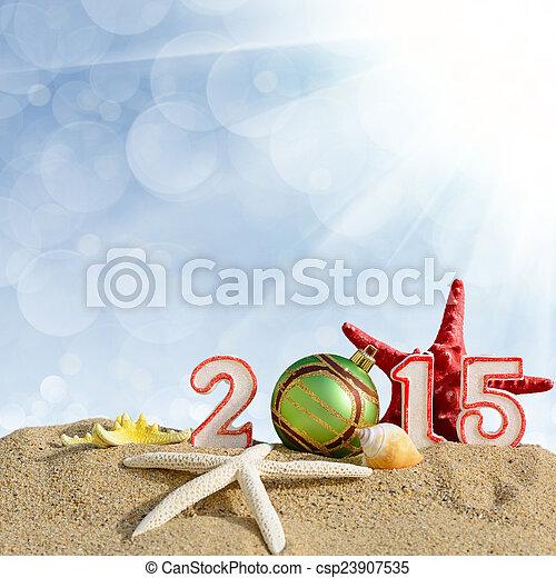 New year 2015 sign on a beach sand - csp23907535