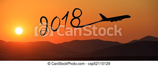 New year 2018 drawing by airplane on the air at sunrise - csp52110129