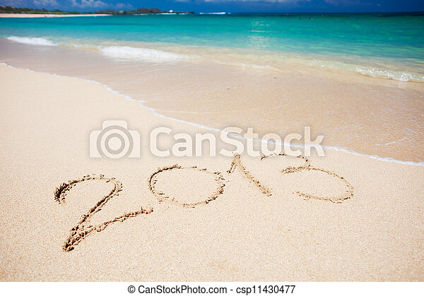 """New year background of beach with """"2013"""" handwritten in the sand, holiday christmas concept - csp11430477"""
