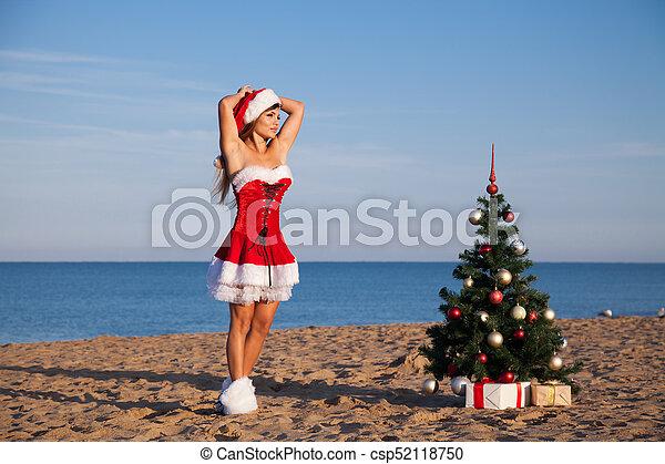 Christmas Beach.New Year Christmas Tree Beach Resort Sea Girl