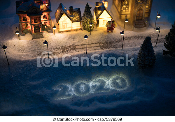 New Year miniature house in the snow at night with fir tree. - csp75379569