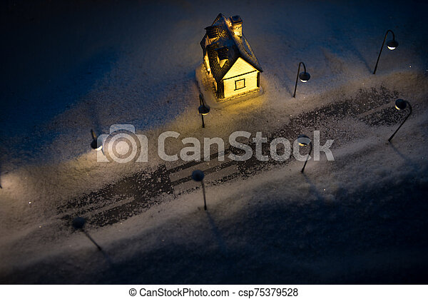 New Year miniature house in the snow at night with fir tree. - csp75379528