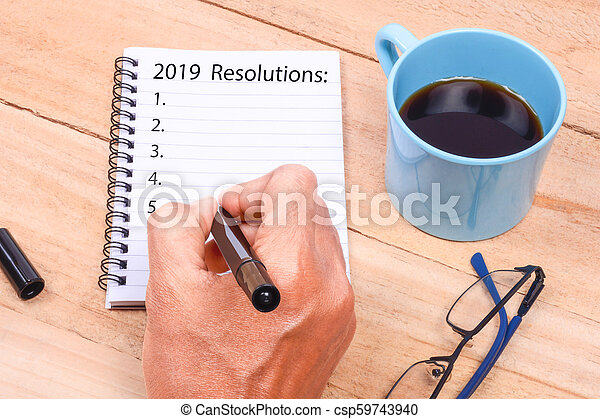 New Year Resolutions List on Notepad - csp59743940