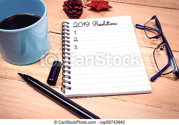 New Year Resolutions List on Notepad - csp59743943