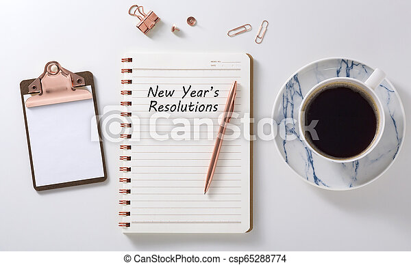 New year resolutions on notebook with coffee cup - csp65288774