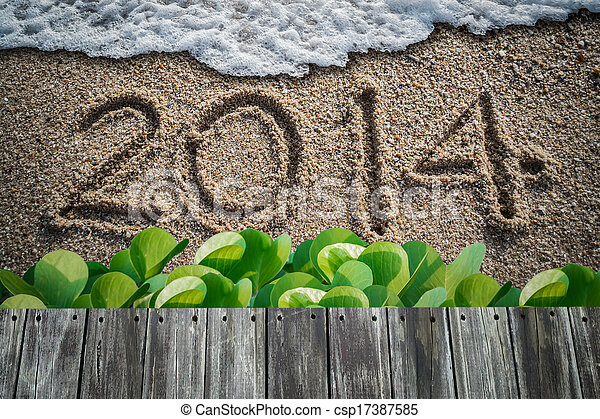 new year with 2014 writen on the beach - csp17387585