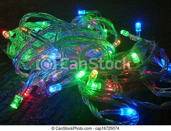 New year's festoon colour light bulb on black background - csp16725074
