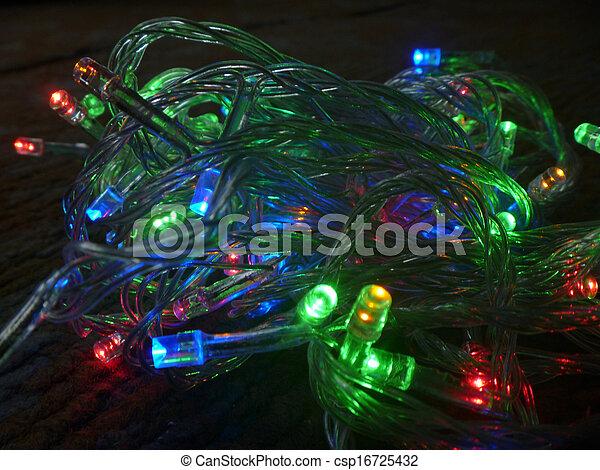 New year's festoon colour light bulb on black background - csp16725432