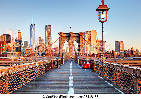 New York City Brooklyn Bridge in Manhattan closeup with skyscrapers and city skyline over Hudson River. - csp38448188