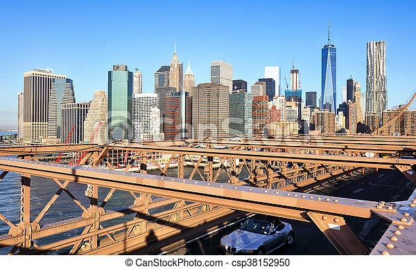 New York City Brooklyn Bridge in Manhattan closeup with skyscrapers and city skyline over Hudson River. - csp38152950