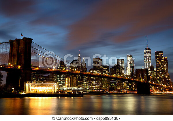 New York City Manhattan Downtown With Brooklyn Bridge At Dusk