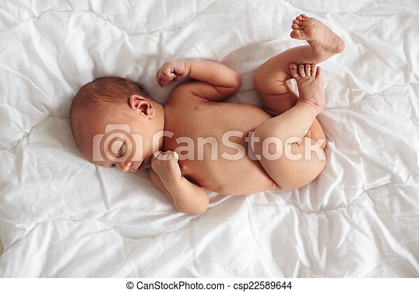 Newborn Baby Boy Lying Naked On Bed Top View Of Newborn Baby Boy