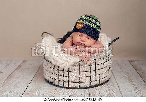 Newborn baby boy wearing a beanie cap. Three week old newborn baby ... 0ffbb87b5ebb