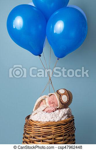 Newborn Baby Boy Wearing an Aviator Hat - csp47962448