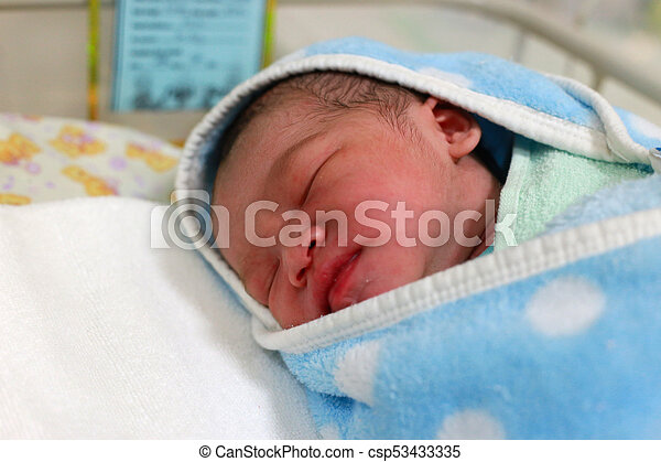 Newborn Baby Boy Wrapped In Blanket In The Hospital