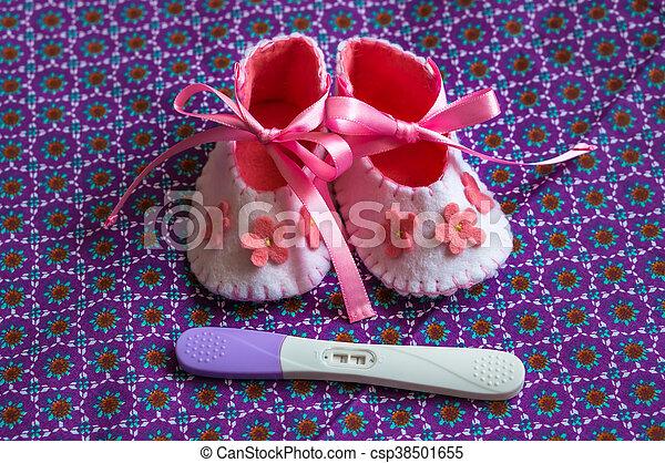 Newborn baby girl booties and pregnancy