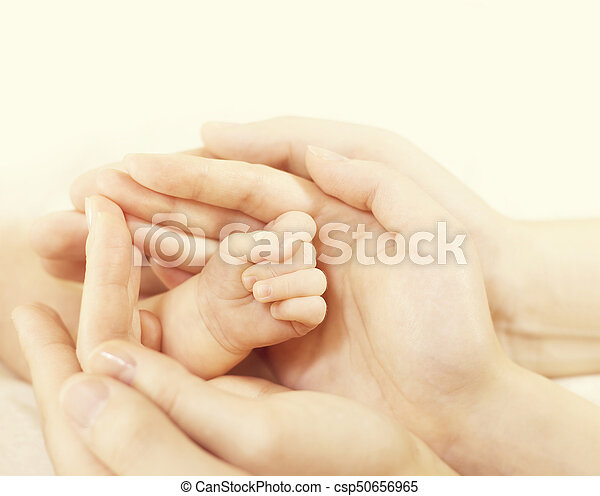 Newborn Baby Hand In Family Hands Parents Hold Protect New Born Kid