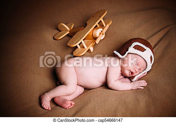 newborn with airplane - csp54666147