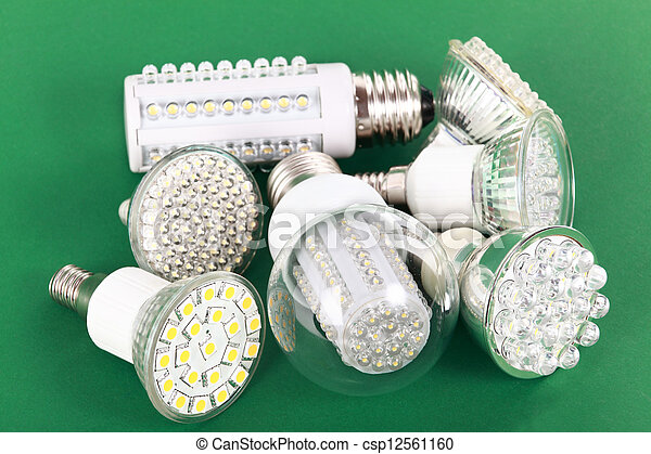 Newest LED light bulb on green - csp12561160