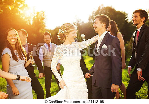 Newlyweds with guest on their garden party - csp24412198
