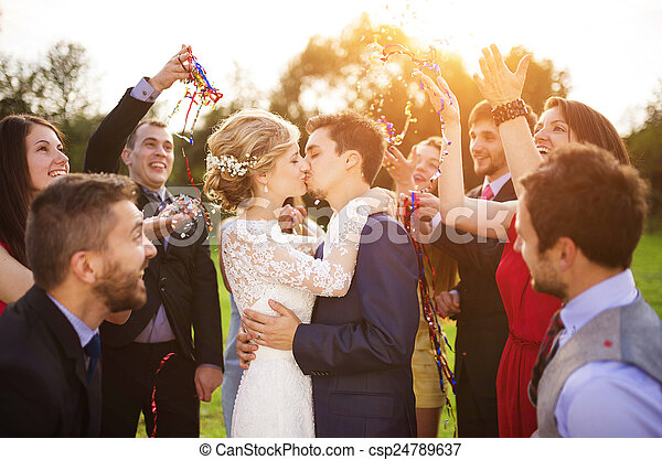 Newlyweds with guest on their garden party - csp24789637