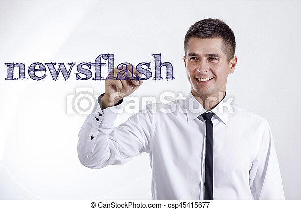 newsflash - Young smiling businessman writing on transparent surface - csp45415677
