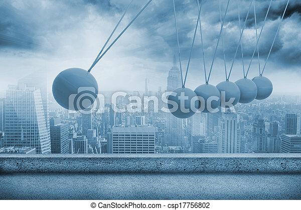 Newtons cradle above city - csp17756802
