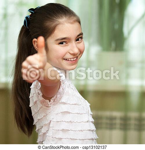 Chica mostrando pulgares arriba - csp13102137