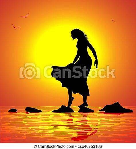 Una chica caminando sobre las rocas - csp46753186