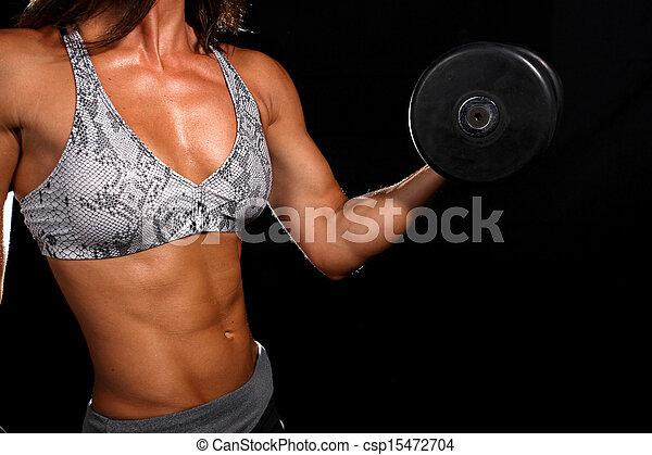 Una chica atractiva haciendo ejercicio - csp15472704