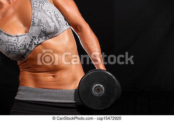 Una chica atractiva haciendo ejercicio - csp15472920