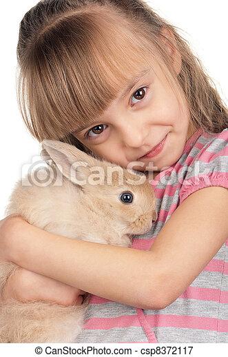 Niña con conejo - csp8372117