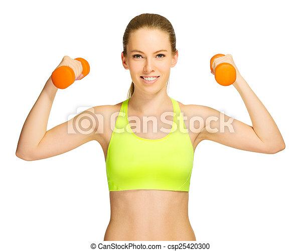 Una joven deportista con pesas - csp25420300