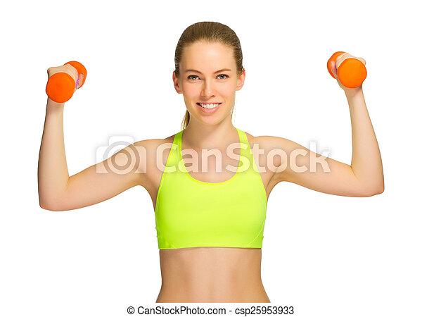 Una joven deportista con pesas - csp25953933