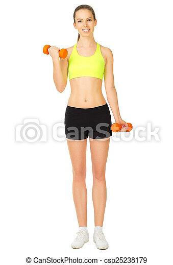 Una joven deportista con pesas - csp25238179