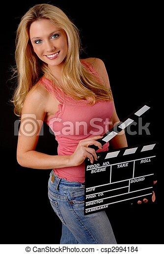 Una rubia encantadora con una tabla de aplausos - csp2994184