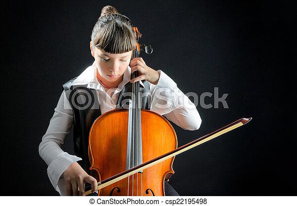 Una chica con violonchelo en el fondo negro - csp22195498